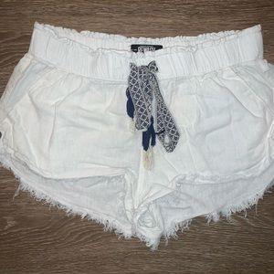 White shorts with blue waist tie. Size M.